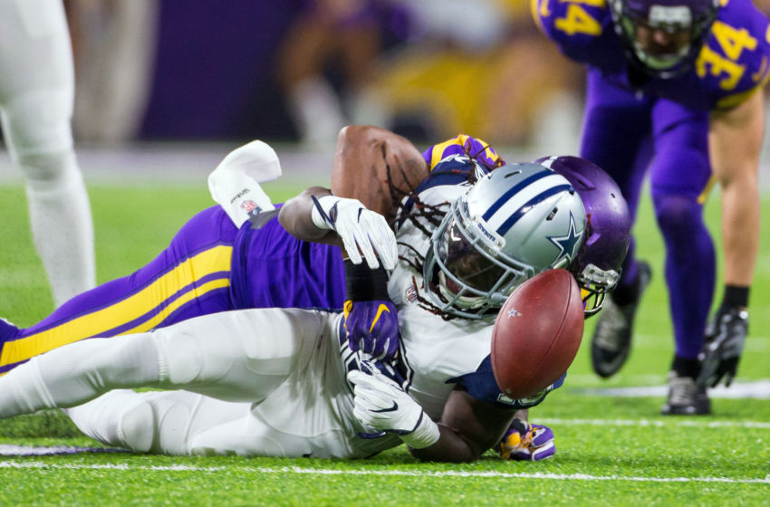 Dec 1, 2016; Minneapolis, MN, USA; Minnesota Vikings defensive lineman Everson Griffen (97) tackles Dallas Cowboys wide receiver Lucky Whitehead (13) for a fumble in the second quarter at U.S. Bank Stadium. Mandatory Credit: Brad Rempel-USA TODAY Sports