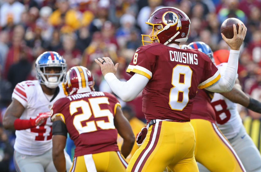 Jan 1, 2017; Landover, MD, USA; Washington Redskins quarterback Kirk Cousins (8) throws the ball as New York Giants cornerback Dominique Rodgers-Cromartie (41) chases in the first quarter at FedEx Field. Mandatory Credit: Geoff Burke-USA TODAY Sports