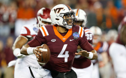 Dec 29, 2016; Charlotte, NC, USA; Virginia Tech Hokies quarterback Jerod Evans (4) looks to pass the ball during the first quarter against the Arkansas Razorbacks during the Belk Bowl at Bank of America Stadium. Mandatory Credit: Jeremy Brevard-USA TODAY Sports