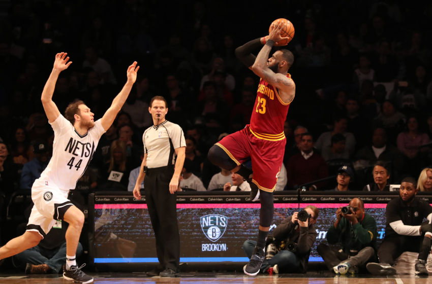 Jan 6, 2017; Brooklyn, NY, USA; Cleveland Cavaliers forward LeBron James (23) shoots over Brooklyn Nets guard Bojan Bogdanovic (44) during the third quarter at Barclays Center. Cleveland Cavaliers won 116-108. Mandatory Credit: Anthony Gruppuso-USA TODAY Sports