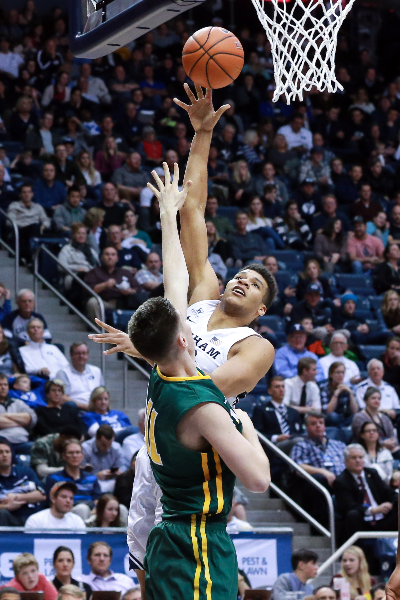 Jan 12, 2017; Provo, UT, USA; Brigham Young Cougars forward Yoeli Childs (23) shoots the ball over San Francisco Dons forward Remu Raitanen (11) during the second half at Marriott Center. Brigham Young Cougars won the game 85-75. Mandatory Credit: Chris Nicoll-USA TODAY Sports