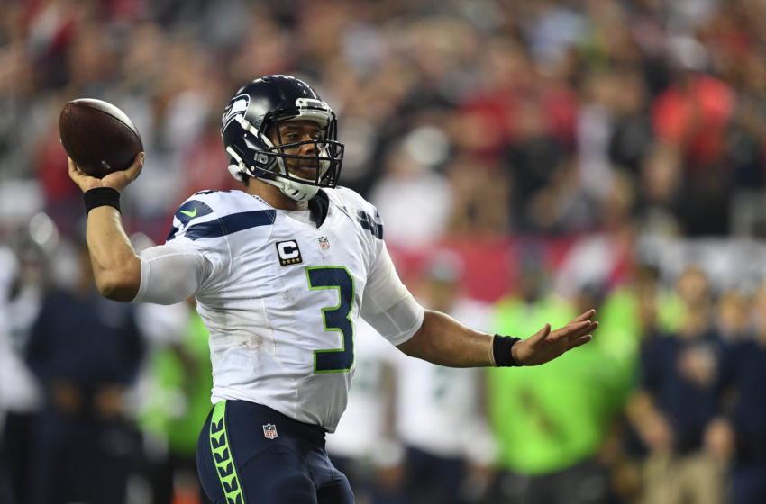 Jan 14, 2017; Atlanta, GA, USA; Seattle Seahawks quarterback Russell Wilson (3) throws against the Atlanta Falcons during the third quarter in the NFC Divisional playoff at Georgia Dome. Mandatory Credit: John David Mercer-USA TODAY Sports