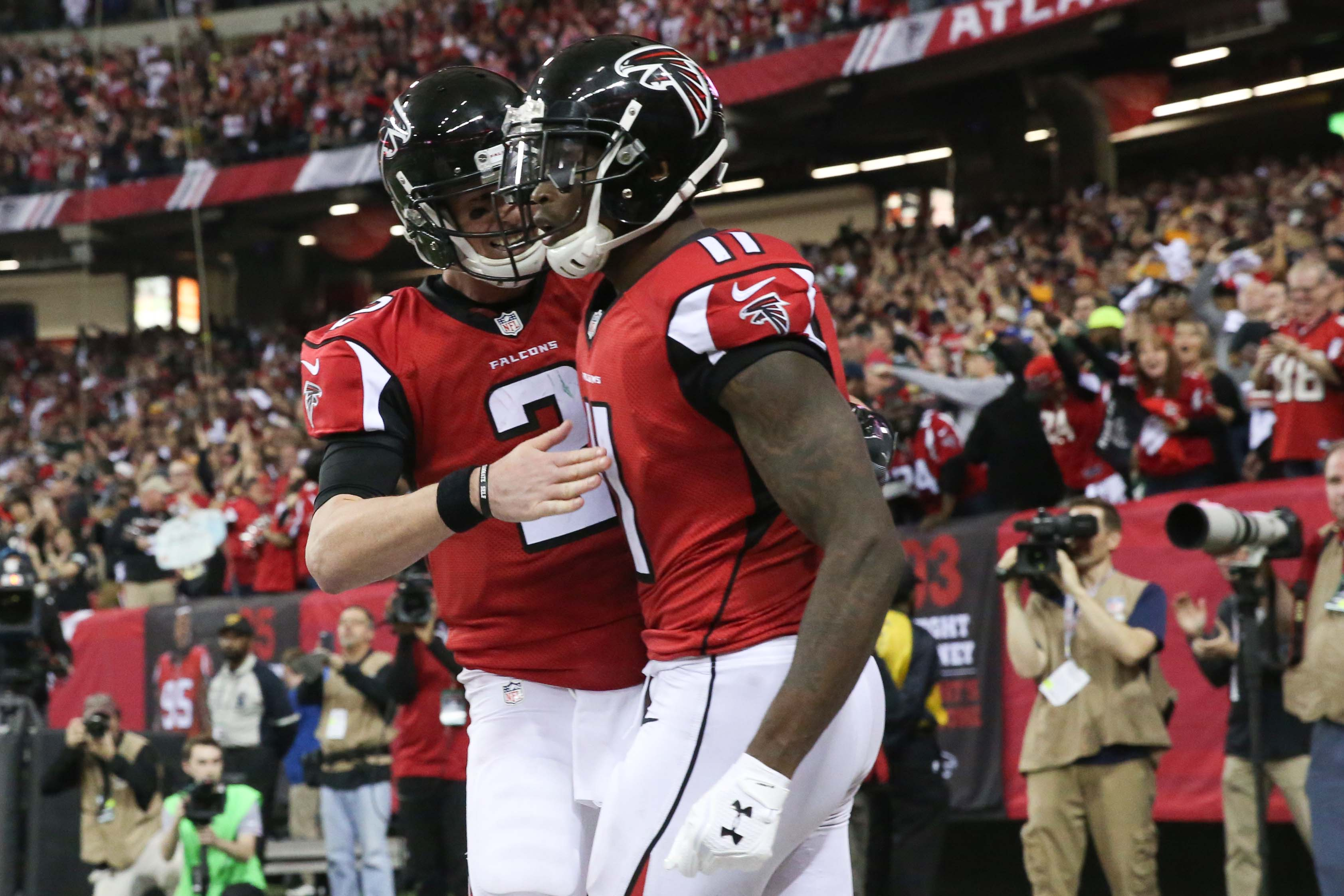 Jan 22, 2017; Atlanta, GA, USA; Atlanta Falcons wide receiver Julio Jones (11) scores a touchdown and is congratulated by quarterback Matt Ryan (2) during the third quarter against the Green Bay Packers in the 2017 NFC Championship Game at the Georgia Dome. Mandatory Credit: Jason Getz-USA TODAY Sports