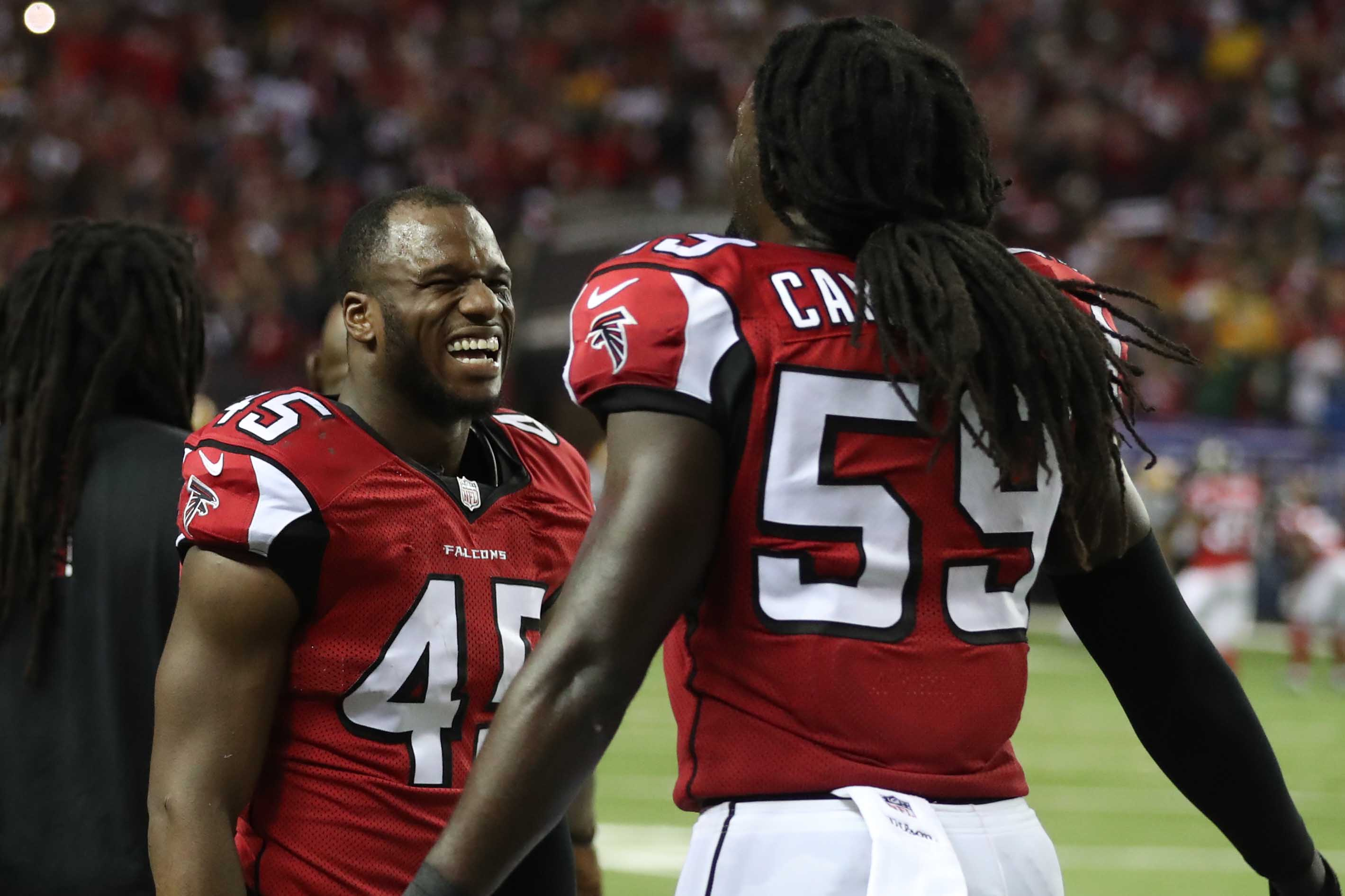 Jan 22, 2017; Atlanta, GA, USA; Atlanta Falcons middle linebacker Deion Jones (45) and outside linebacker De'Vondre Campbell (59) react on the sidelines during the fourth quarter against the Green Bay Packers in the 2017 NFC Championship Game at the Georgia Dome. Atlanta defeated Green Bay 44-21. Mandatory Credit: Jason Getz-USA TODAY Sports