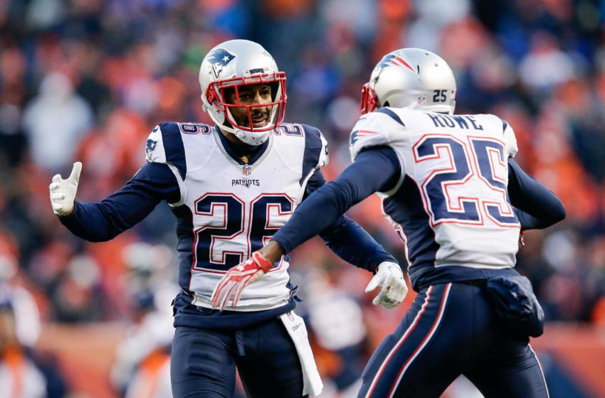 Dec 18, 2016; Denver, CO, USA; New England Patriots cornerback Logan Ryan (26) celebrates with defensive back Eric Rowe (25) after a play in the third quarter against the Denver Broncos at Sports Authority Field at Mile High. Mandatory Credit: Isaiah J. Downing-USA TODAY Sports