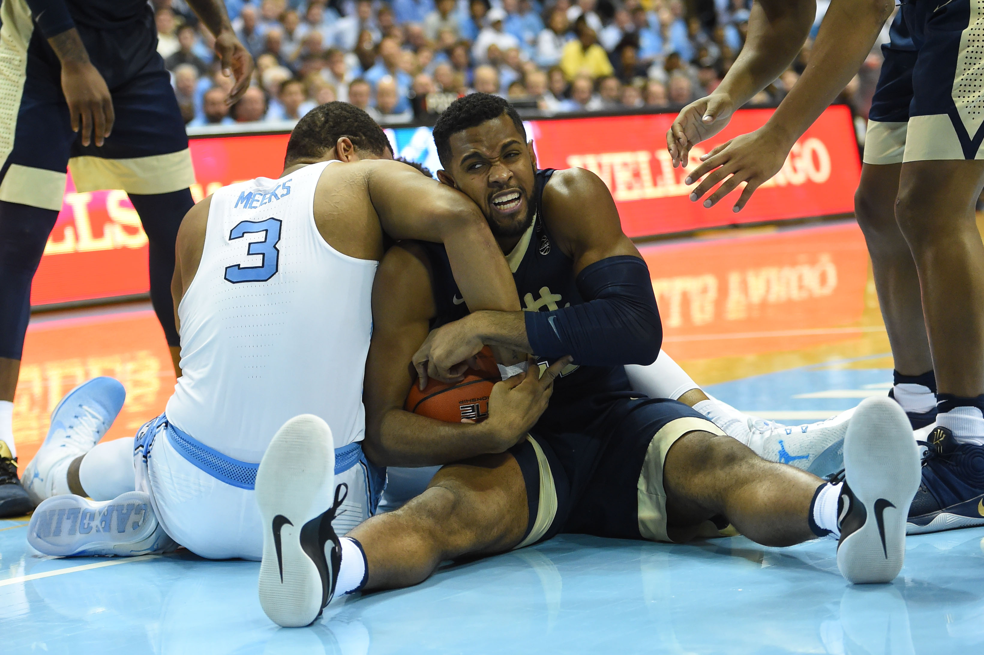 Jan 31, 2017; Chapel Hill, NC, USA; North Carolina Tar Heels forward Kennedy Meeks (3) and Pittsburgh Panthers forward Sheldon Jeter (21) fight for the ball in the second half. The Tar Heels defeated the Panthers 80-78 at Dean E. Smith Center. Mandatory Credit: Bob Donnan-USA TODAY Sports