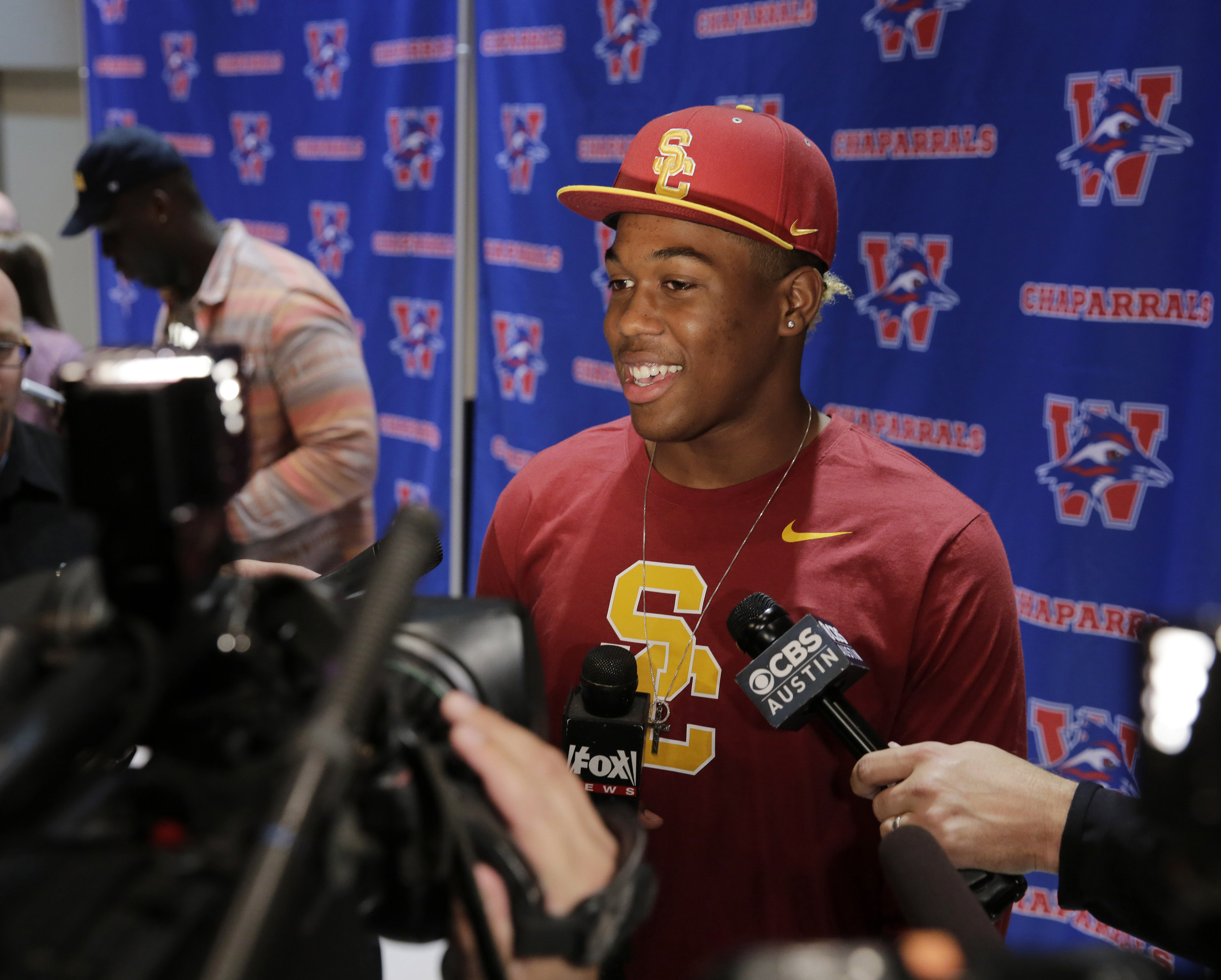 Feb 1, 2017; Austin, TX, USA; Levi Jones announces his commitment to the University of Southern California during National Signing Day at Westlake High School. Mandatory Credit: Erich Schlegel-USA TODAY Sports