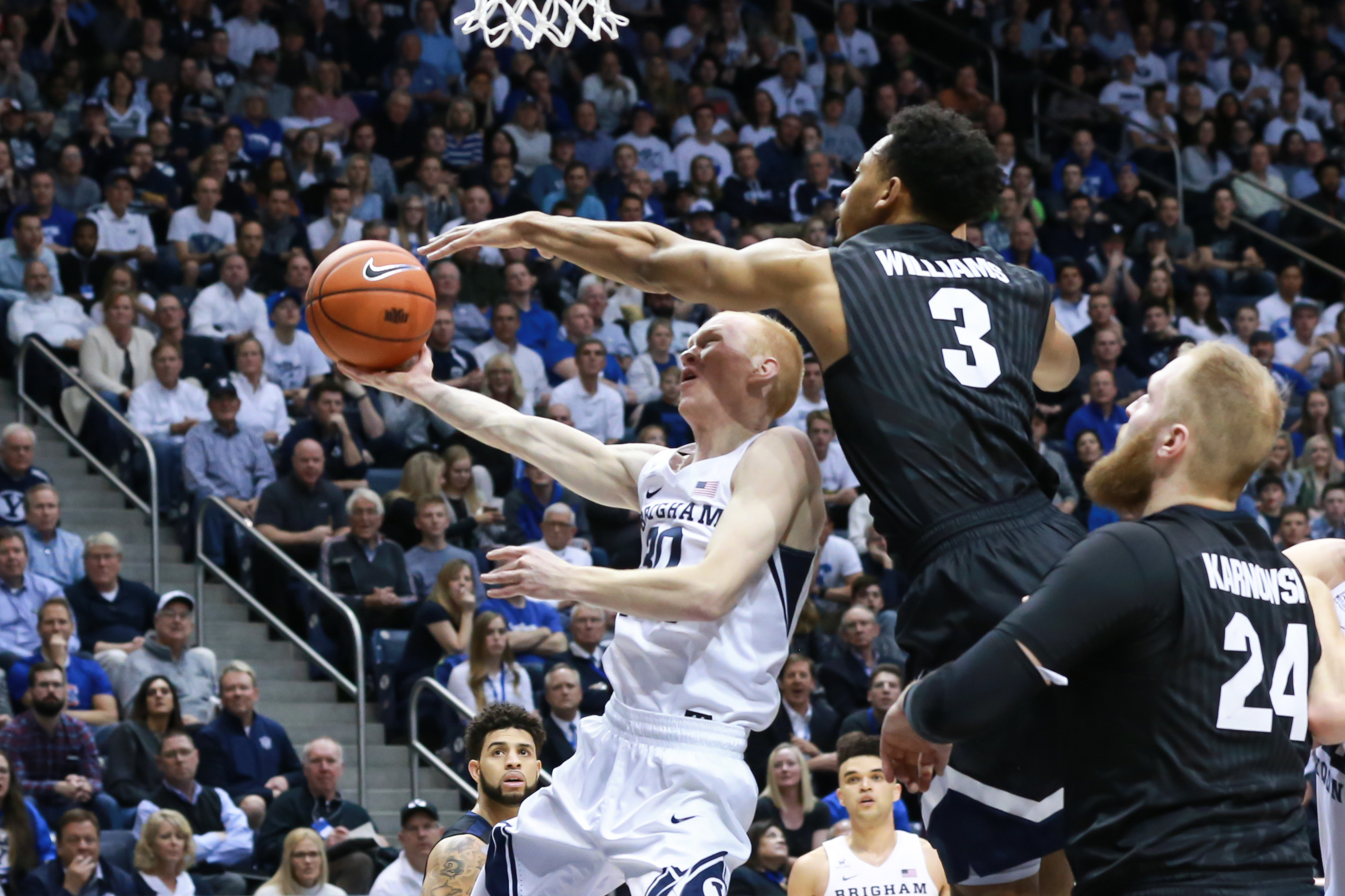 Feb 2, 2017; Provo, UT, USA; Brigham Young Cougars guard TJ Haws (30) is fouled by Gonzaga Bulldogs forward Johnathan Williams (3) while shooting during the second half at Marriott Center. The Bulldogs won 85-75. Mandatory Credit: Chris Nicoll-USA TODAY Sports