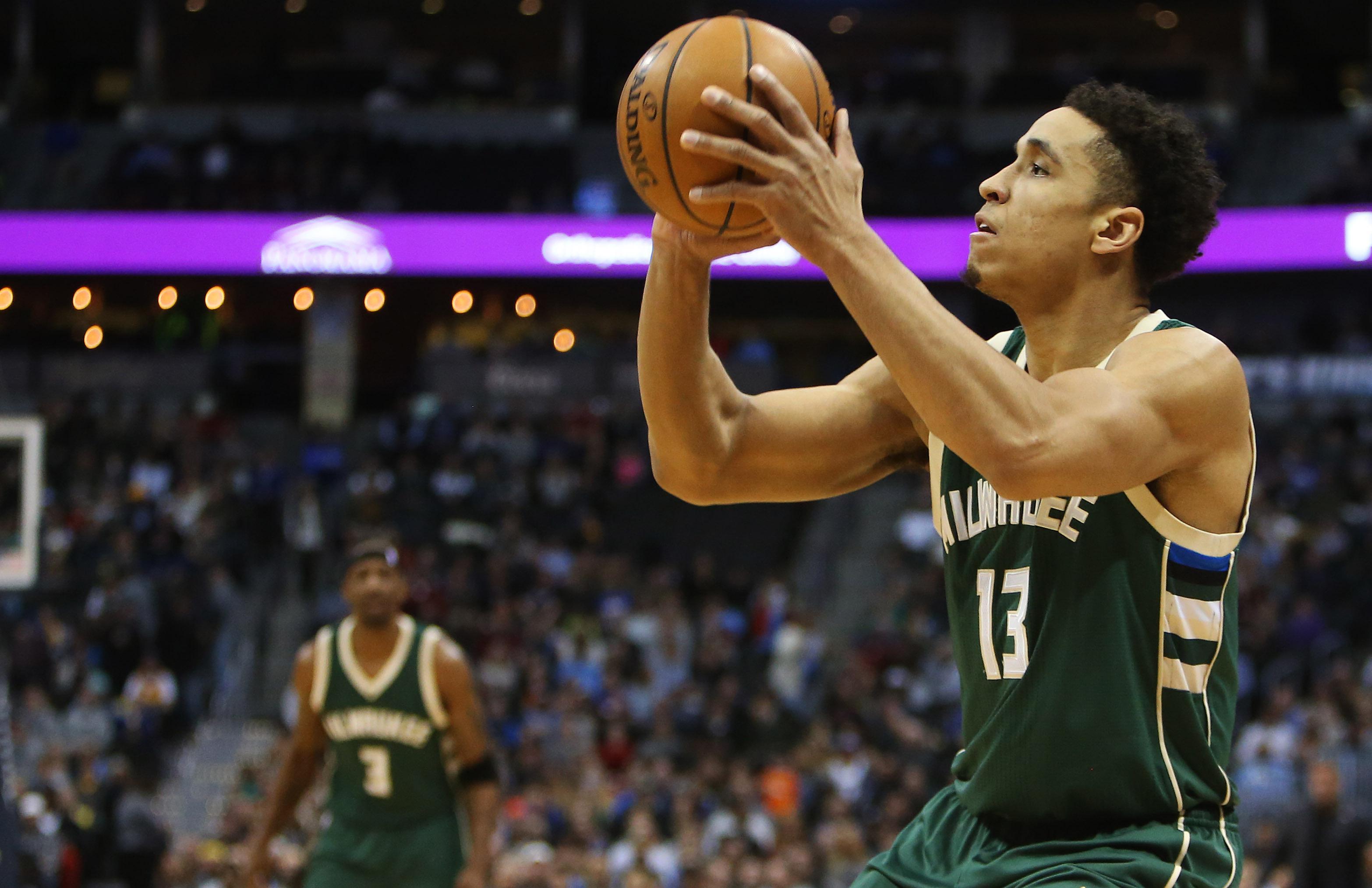 Feb 3, 2017; Denver, CO, USA; Milwaukee Bucks guard Malcolm Brogdon (13) shoots the ball during the first half against the Denver Nuggets at Pepsi Center. Mandatory Credit: Chris Humphreys-USA TODAY Sports