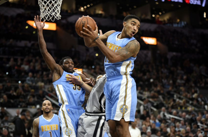 Feb 4, 2017; San Antonio, TX, USA; Denver Nuggets guard Gary Harris (14) grabs a rebound against the San Antonio Spurs during the first half at the AT&T Center. Mandatory Credit: Brendan Maloney-USA TODAY Sports