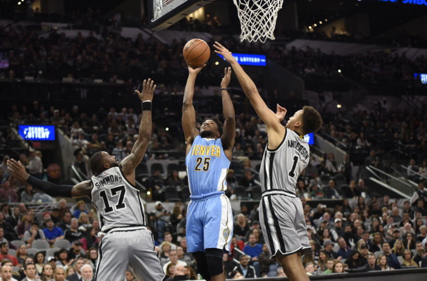 Feb 4, 2017; San Antonio, TX, USA; Denver Nuggets guard Malik Beasley (25) shoots against San Antonio Spurs forward Jonathon Simmons (17) and guard Kyle Anderson (1) during the second half at the AT&T Center. The Spurs won 121-97. Mandatory Credit: Brendan Maloney-USA TODAY Sports