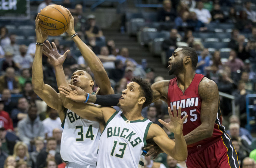 Feb 8, 2017; Milwaukee, WI, USA; Milwaukee Bucks forward Giannis Antetokounmpo (34) and guard Malcolm Brogdon (13) and Miami Heat forward Willie Reed (35) reach for a rebound during the first quarter at BMO Harris Bradley Center. Mandatory Credit: Jeff Hanisch-USA TODAY Sports