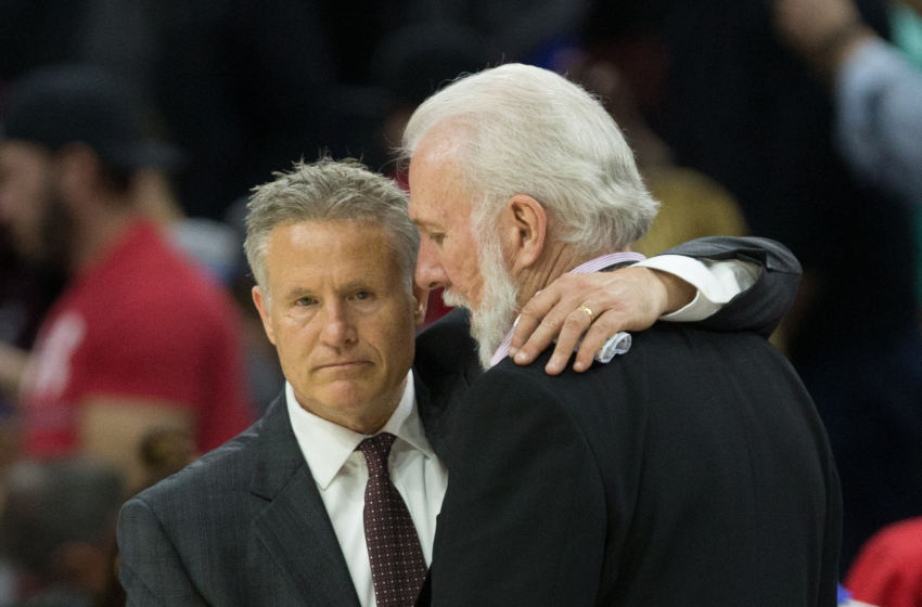 Feb 8, 2017; Philadelphia, PA, USA; Philadelphia 76ers head coach Brett Brown (L) talks with San Antonio Spurs head coach Gregg Popovich (R) at the conclusion of the game at Wells Fargo Center. The San Antonio Spurs won 111-103. Mandatory Credit: Bill Streicher-USA TODAY Sports