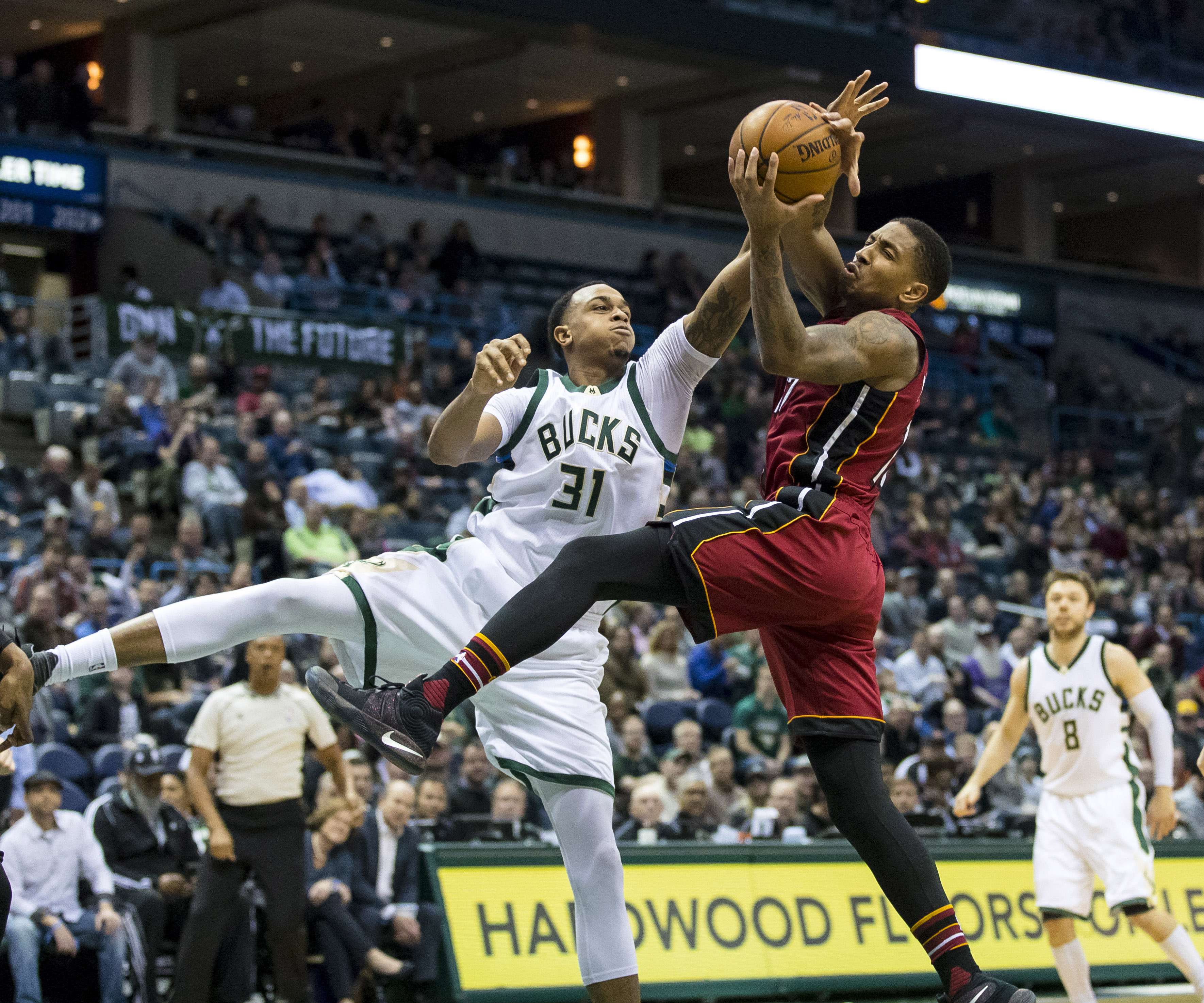 Feb 8, 2017; Milwaukee, WI, USA; Milwaukee Bucks center John Henson (31) and Miami Heat guard Rodney McGruder (17) reach for the ball during the third quarter at BMO Harris Bradley Center. Mandatory Credit: Jeff Hanisch-USA TODAY Sports