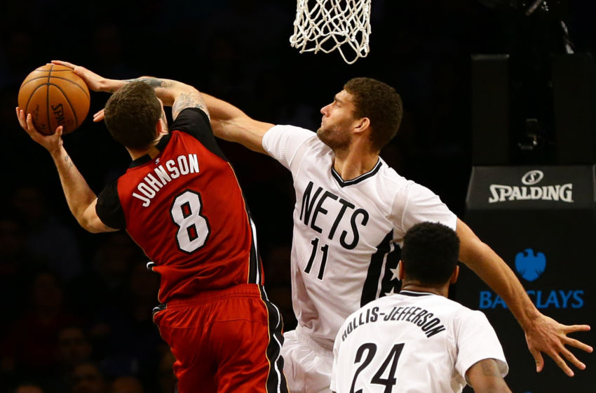 Feb 10, 2017; Brooklyn, NY, USA; Brooklyn Nets center Brook Lopez (11) goes up to block a shot by Miami Heat guard Tyler Johnson (8) during the second half at Barclays Center. Maimi won 108-99. Mandatory Credit: Andy Marlin-USA TODAY Sports