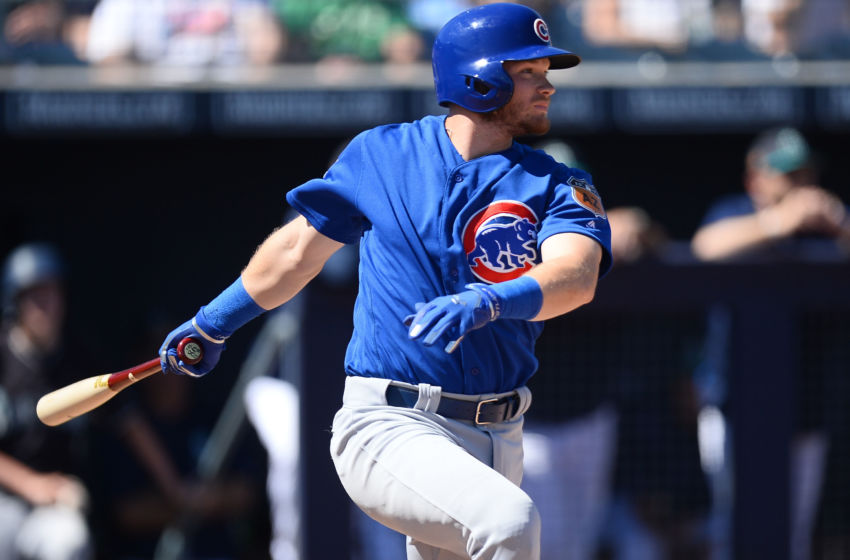 Mar 10, 2017; Peoria, AZ, USA; Chicago Cubs center fielder Ian Happ (86) hits a single against the Seattle Mariners during the second inning at Peoria Stadium. Mandatory Credit: Joe Camporeale-USA TODAY Sports