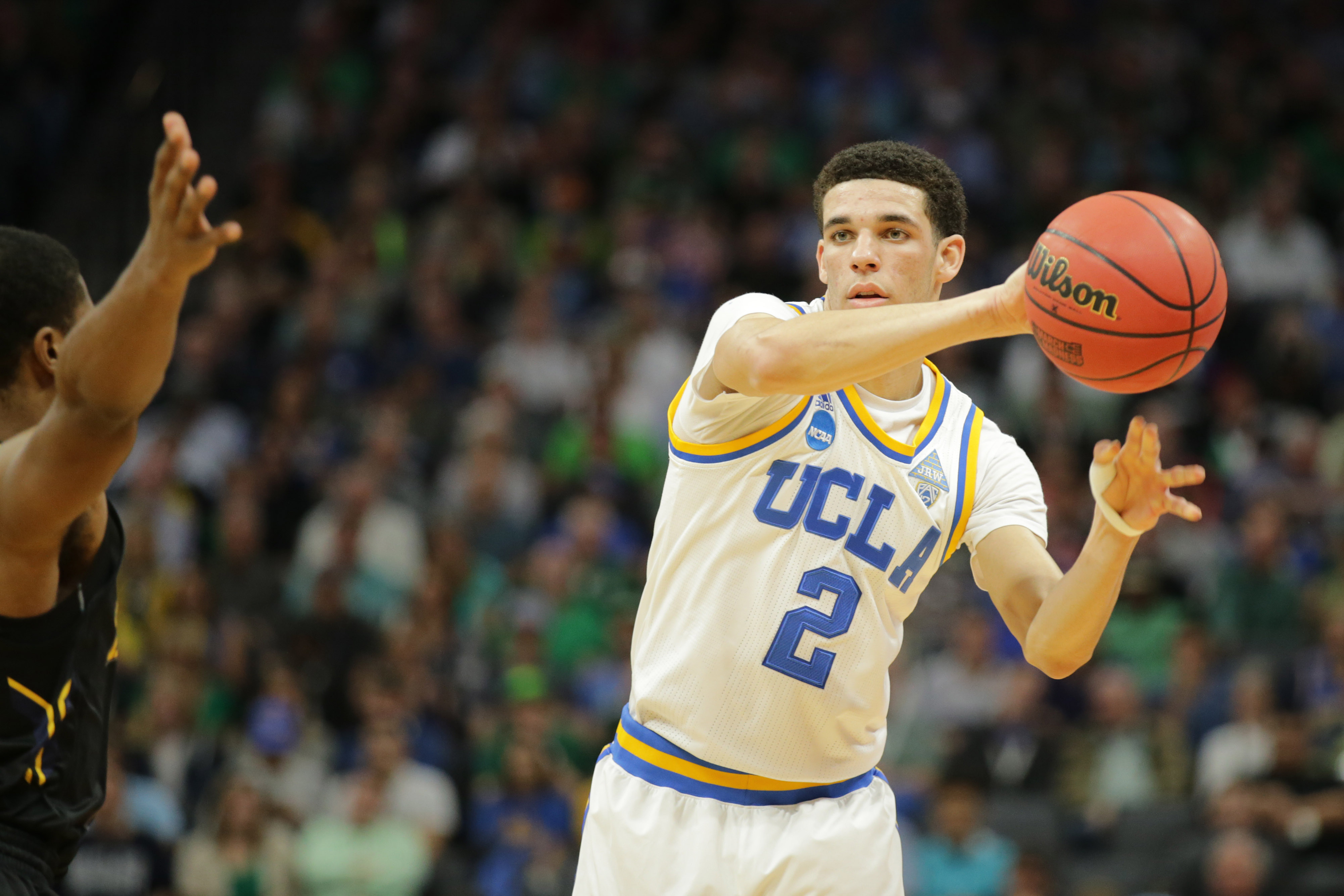 9951715-ncaa-basketball-ncaa-tournament-first-round-kent-state-and-ucla-bruins