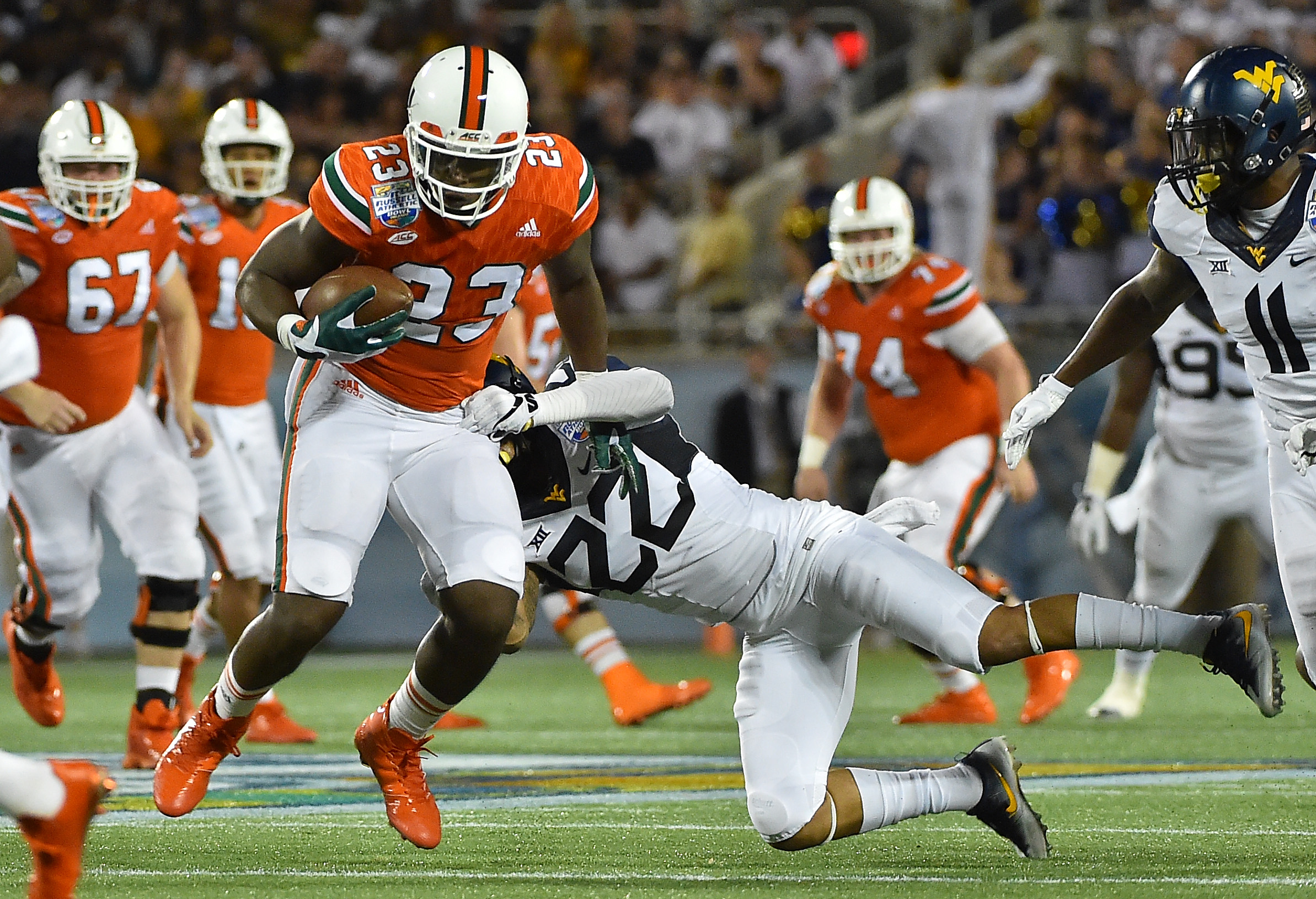 9772377-ncaa-football-russell-athletic-bowl-west-virginia-vs-miami