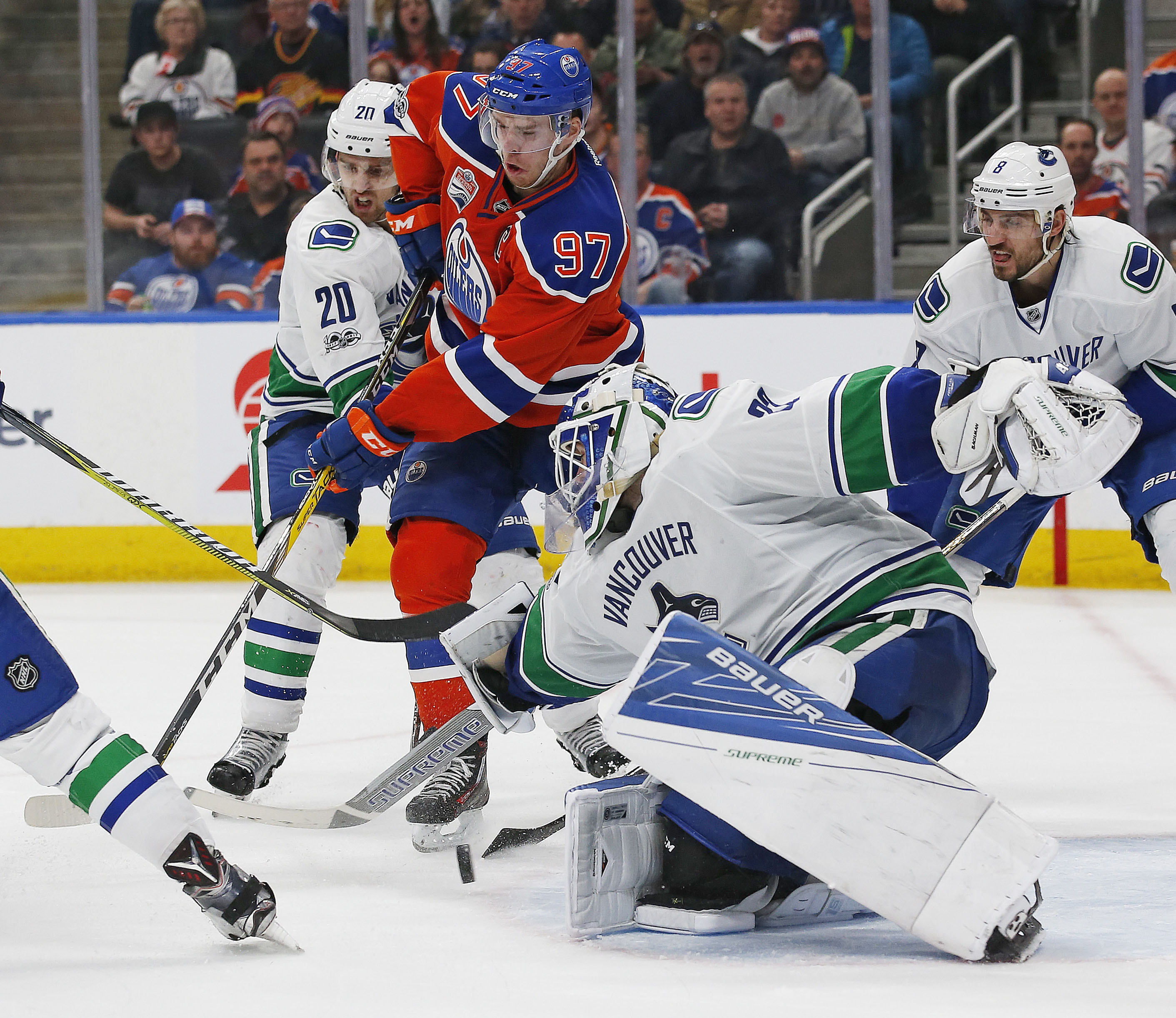 Oilers beat Canucks 3-2 to clinch second in Pacific Division