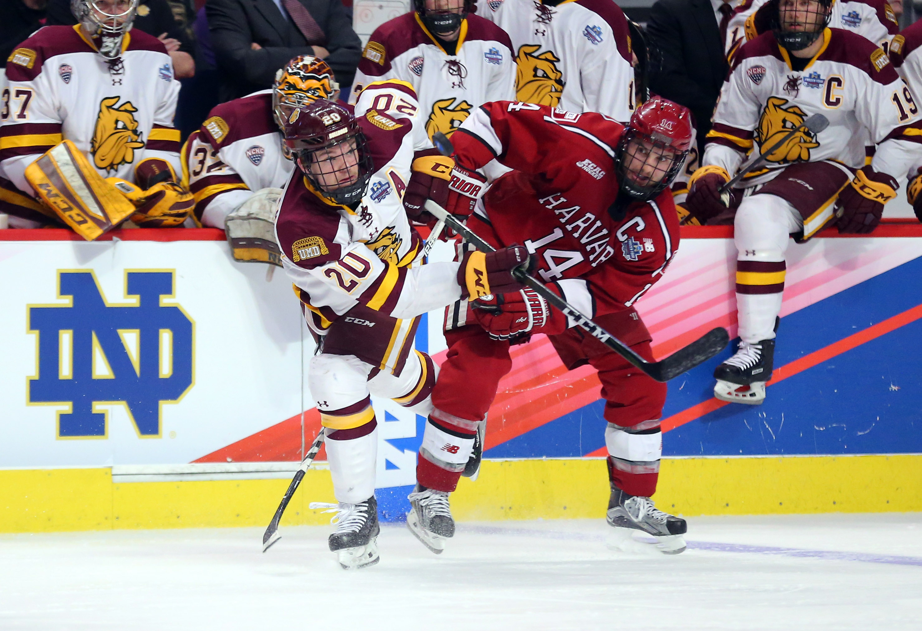 chicago blackhawks playing style proving successful in college ranks apr 6 2017 chicago il usa minnesota duluth bulldogs wing karson kuhlman 20 and harvard crimson forward alexander kerfoot 14 battle for possession