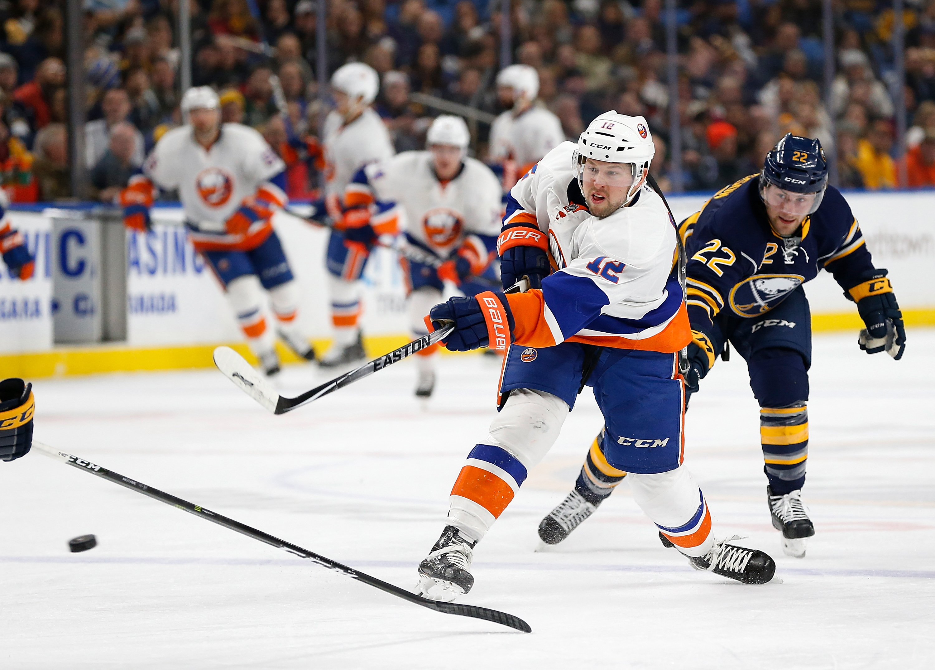 Islanders trade D Hamonic to Flames for 3 draft picks
