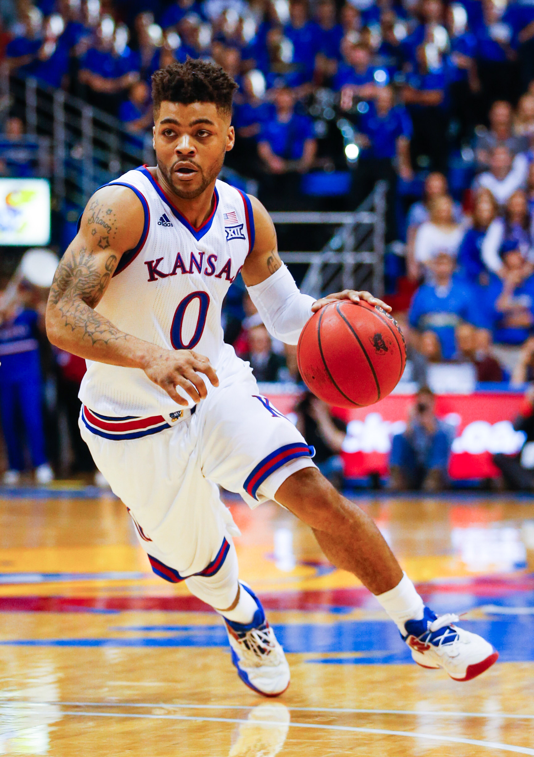9855490-ncaa-basketball-texas-at-kansas